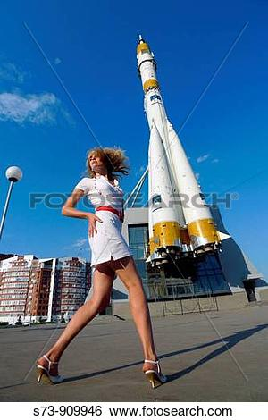 Stock Images of Woman front the Russian space transport rocket. A.