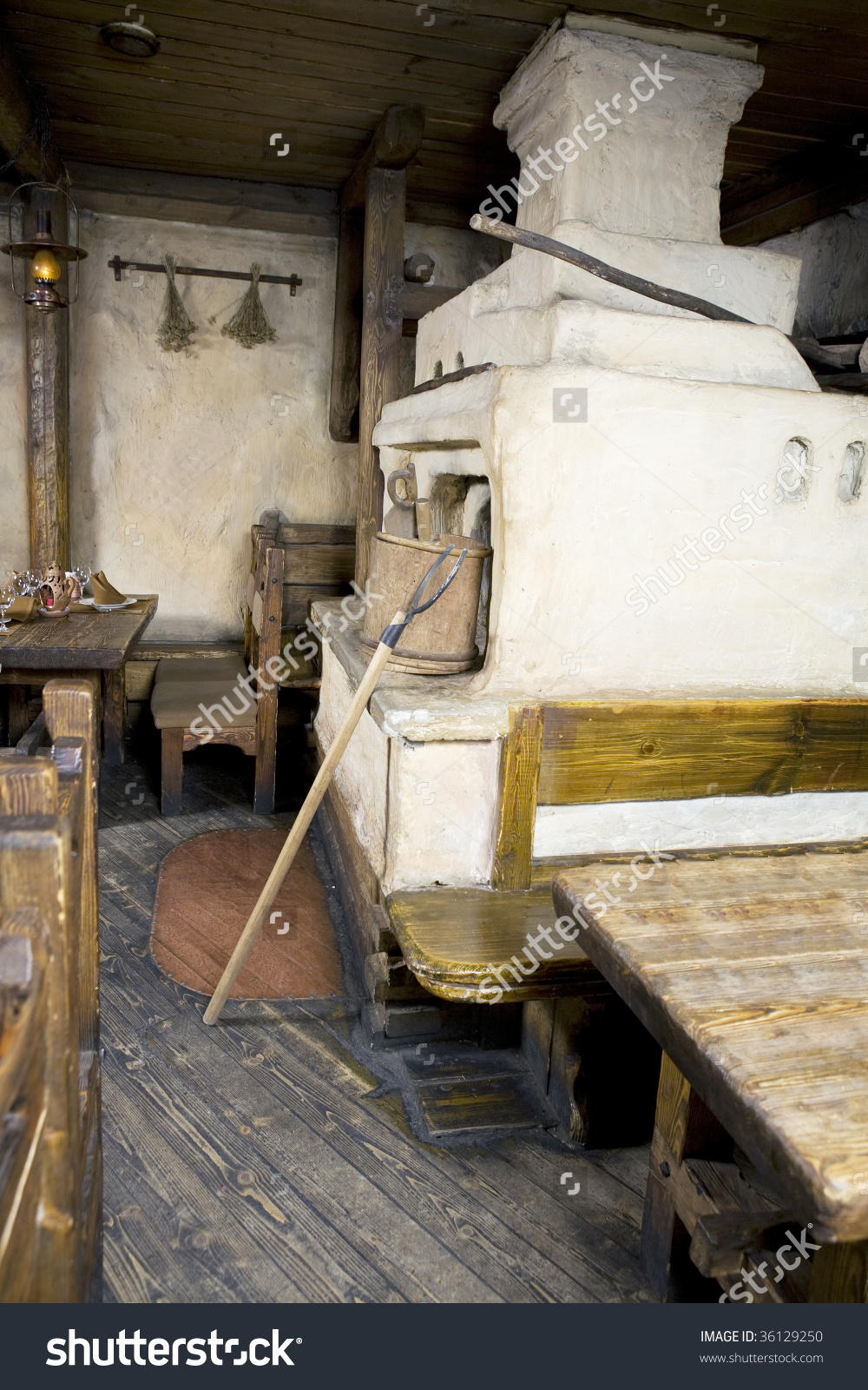 Russian Stove. Interior Of Old Russian Home With Traditional Oven.