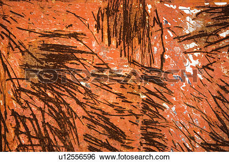 Stock Images of Old rusted orange metal siding with scratch marks.