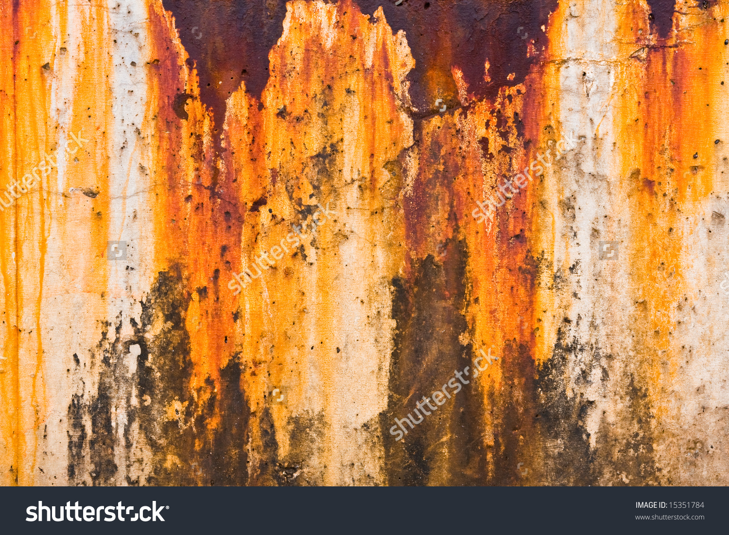 Colorful Rust Stains Along A Harbor Breakwater. Stock Photo.