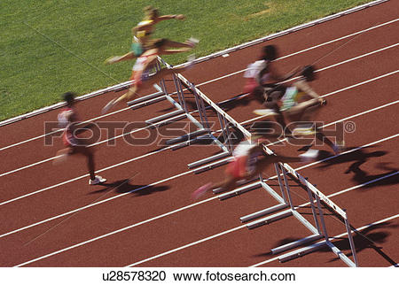 Stock Photography of Track and field competition, hurdlers on rust.