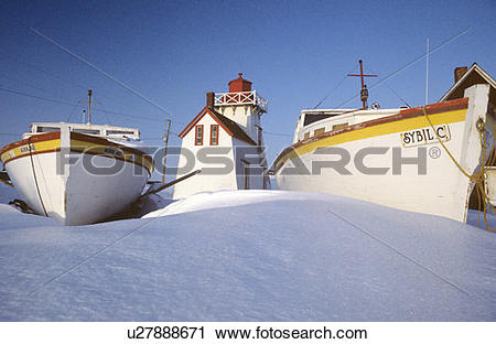 Stock Photography of Fishing boats and Lighthouse in winter, North.