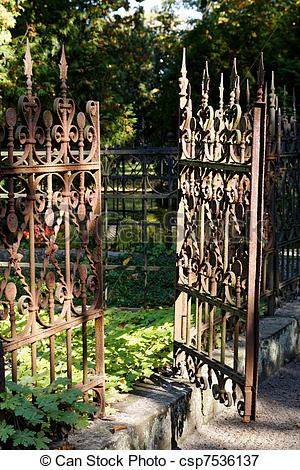 Picture of Open Rusty Iron Gate at Cemetery.
