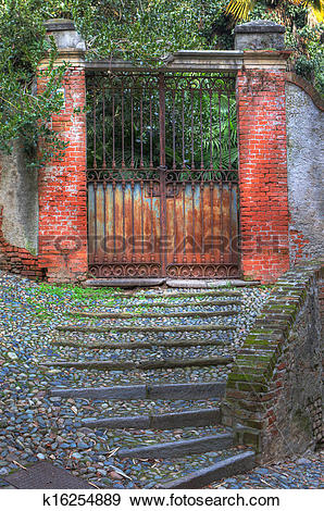 Stock Photograph of Old rusty gate and paved stairs in Saluzzo.