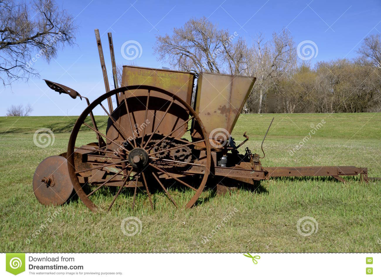 Old Rusty Potato Planting Machinery Stock Photo.