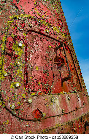 Stock Images of Rusty red marker buoy with steel hatch.