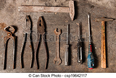 Stock Photography of Workbench with rusty tools csp19642117.