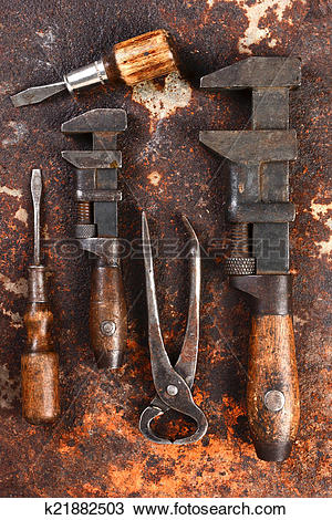 Stock Photo of Old Hand Tools on Rusty Surface k21882503.