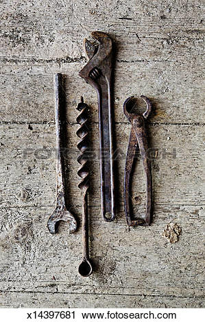 Stock Photography of Old rusty tools on a wooden floor x14397681.