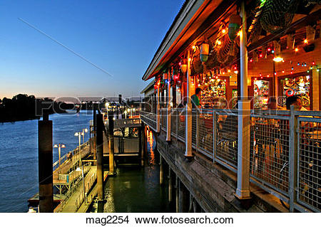 Stock Photo of Restaurant seating along Sacramento River Old Town.