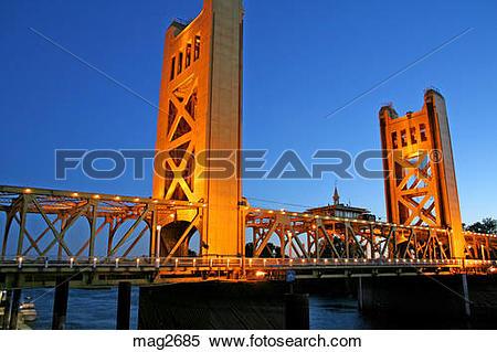 Stock Image of Evening lighting Tower Bridge over Sacramento River.