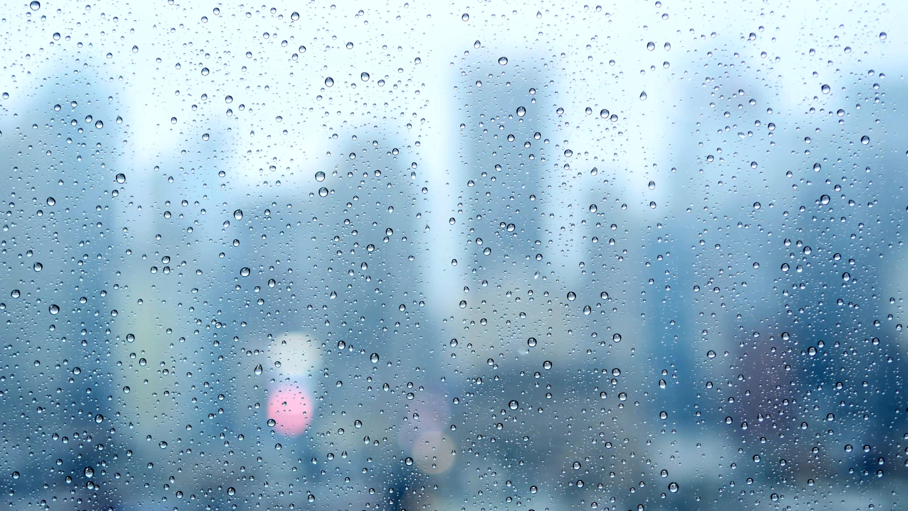 moddy wet weather background. raining city scenery. sad rain drops.