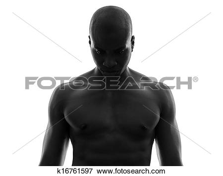 Picture of african black man topless looking down sad silhouette.