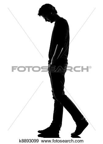 Stock Photograph of young man silhouette sad walking k8893099.