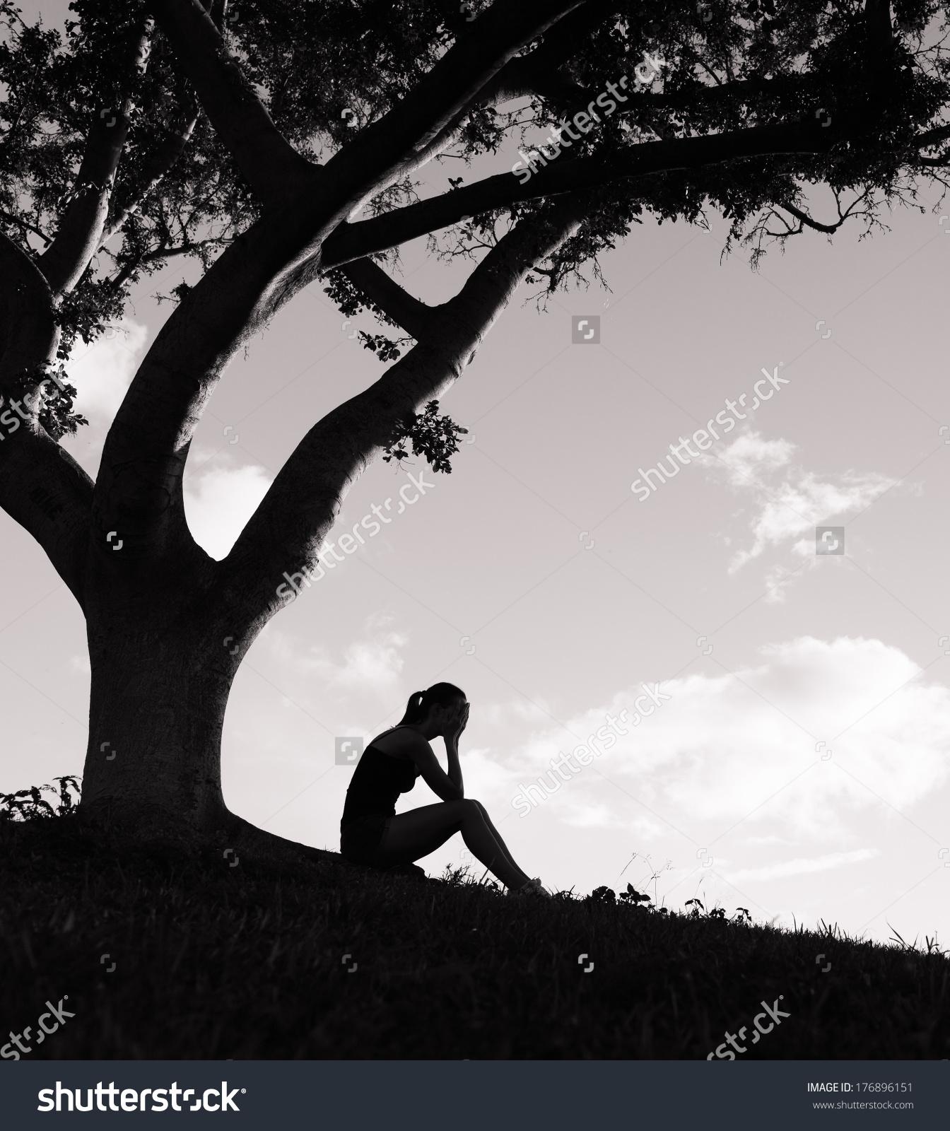 Silhouette Sad Woman Sitting Under Tree Stock Photo 176896151.