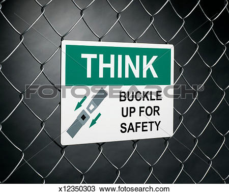 Stock Photo of 'Think buckle up for safety' sign on fence.