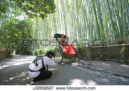 Picture of Two young women sitting in rickshaw in Sagano, Kyoto.