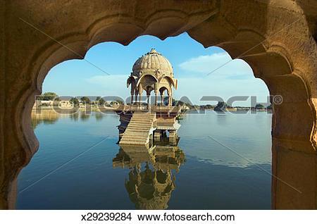 Stock Photo of Temple in Gadi Sagar Lake, viewed through archway.