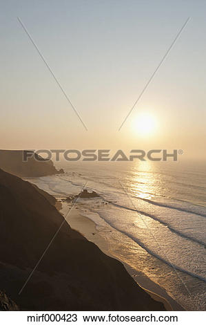Stock Photo of Portugal, Algarve, Sagres, View of beach at sunset.