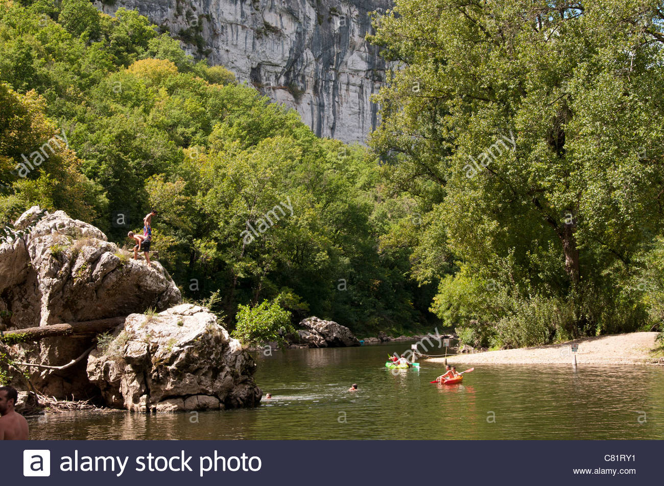 People Swimming And Canoeing In The River Of Aveyron Stock Photo.