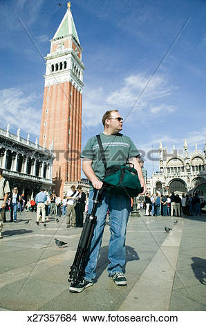 Stock Photo of Tourist standing on St. Mark's Square in Venice.