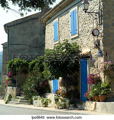 Stock Image of house with blue shutters and doors saint.