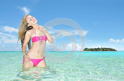 The Beautiful Young Woman Against The Tropical Island Stock Photo.