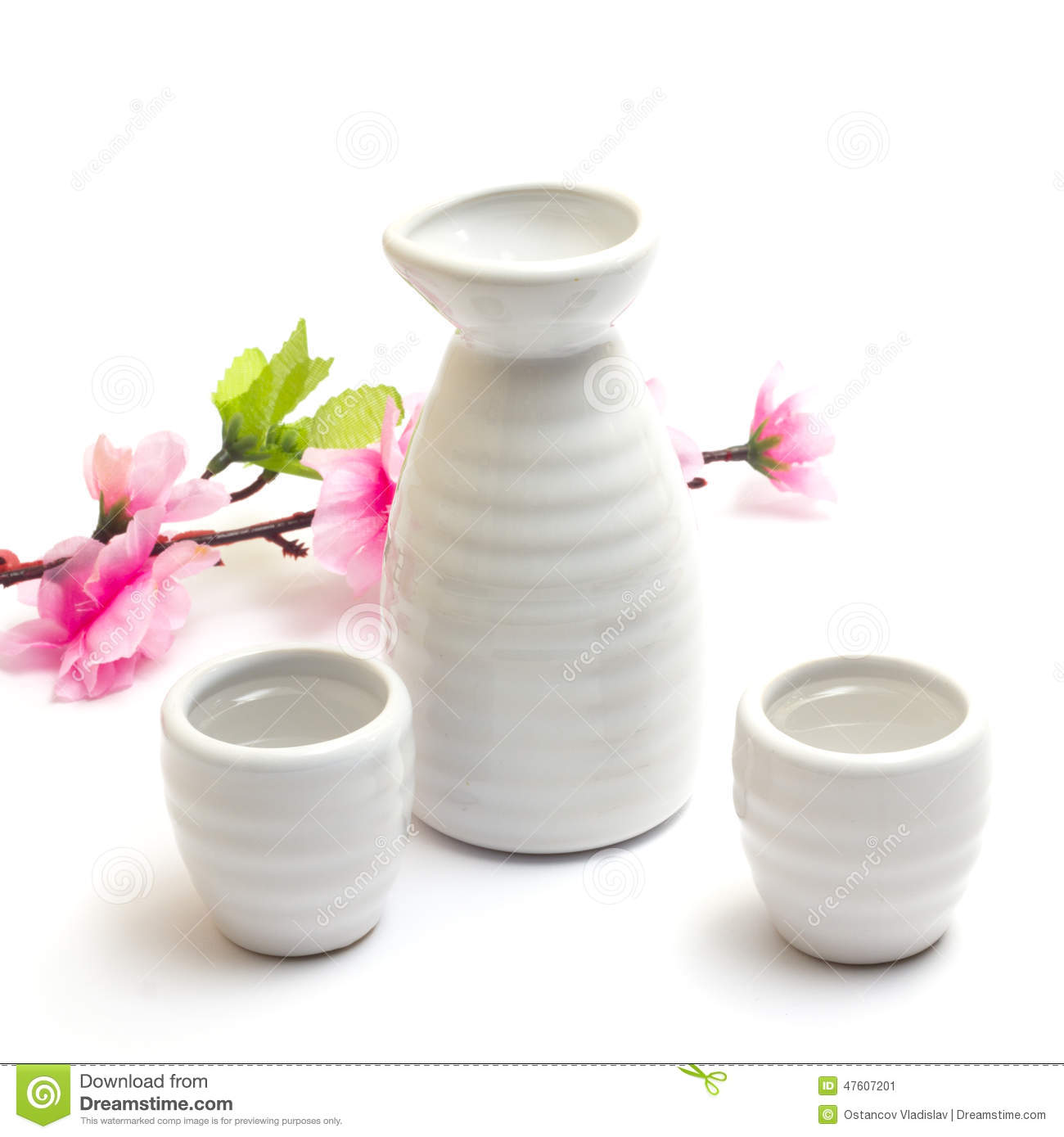 Japanese Traditional Sake Cups And Bottle With Sakura Stock Photo.