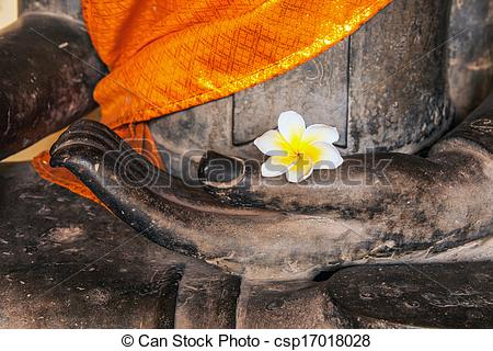 Stock Photo of Buddha image with yellow robe, flower (Plumeria or.
