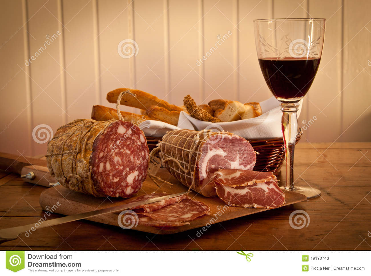 A Glass Of Wine With Salami And Home.