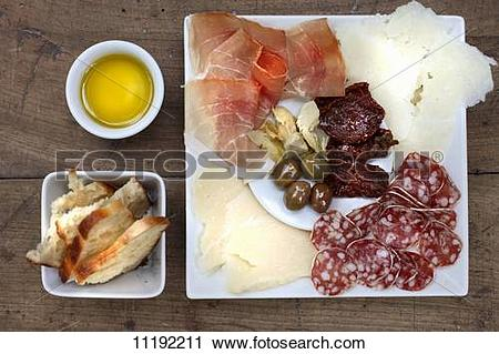 Stock Photography of Antipasti: sundried tomatoes, olives.