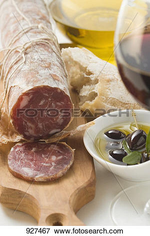 Picture of Italian salami, olives in olive oil, white bread 927467.