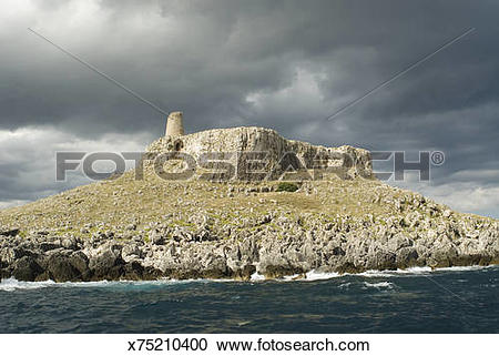 Stock Photography of Italy, Puglia, Otranto, ancient rock tower.