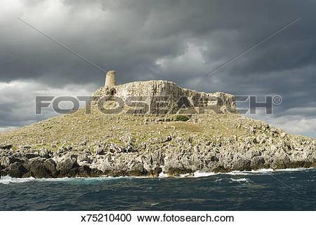 Stock Photography of Italy, Puglia, Otranto, ancient rock tower.