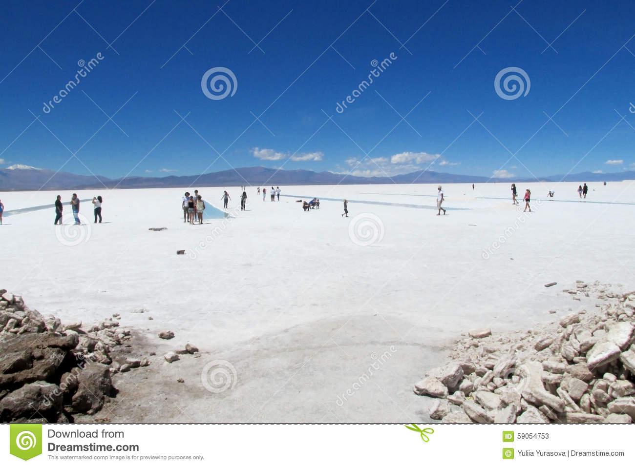 People Walking On A Salt Lake Stock Photo.