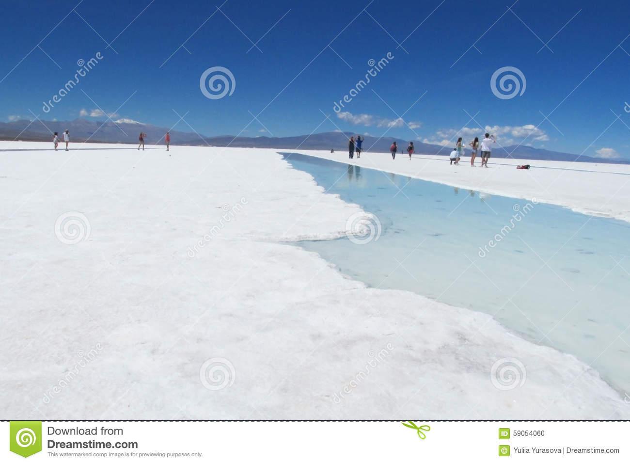 People Walking On A Salt Lake Editorial Image.