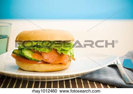 Stock Photography of Cold smoked salmon bagel on the table.