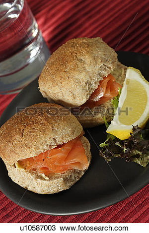 Stock Photo of Organic wholemeal roll with salmon u10587003.