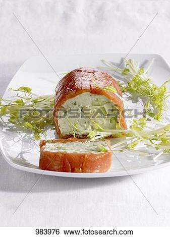 Stock Images of Avocado and salmon roulade with bean sprouts.