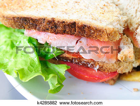 Clip Art of Fresh Salmon Sandwich and French fries k4285882.