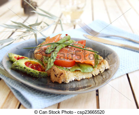 Stock Photo of Hot a salty salmon sandwich, sparzhy and mamadik.