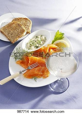 Stock Photo of Smopked salmon with a lemon and dill sauce, toast.