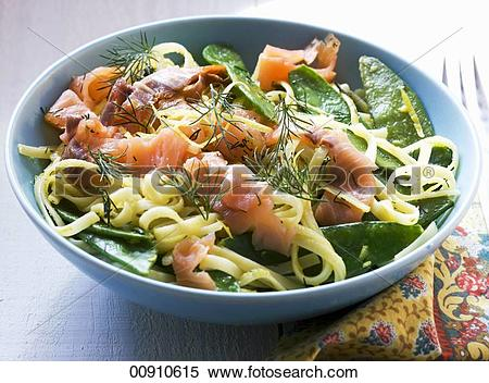 Stock Image of Tagliatelle with smoked salmon, mange tout and.