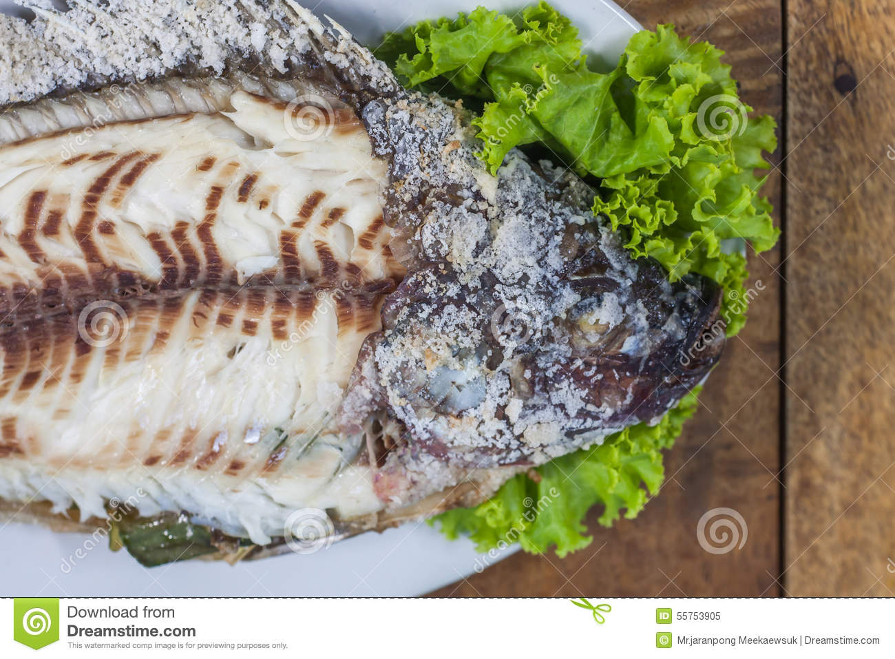 Salt Crusted Grilled Fish Stock Photo.