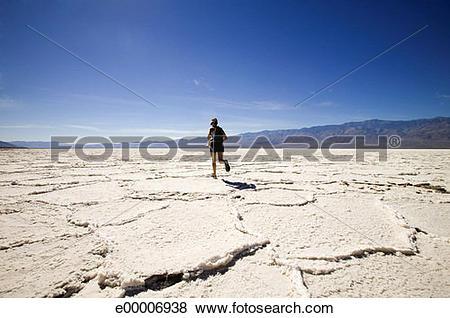 Pictures of Woman running in cracked desert landscape, Bonneville.