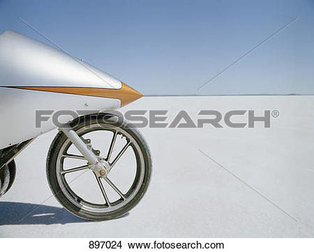 Stock Photo of Detail of a racing motorcycle on a salt flat, Lake.