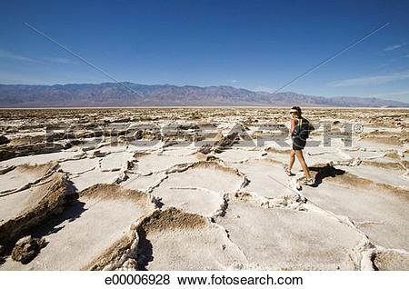 Pictures of Woman hiking in cracked desert landscape, Bonneville.