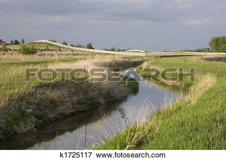 Picture of irrigation ditch, green meadows and pasture k1725117.