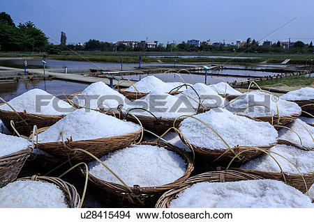 Stock Photo of Salt mountain Pudai Zhounan salt pan Taiwan.