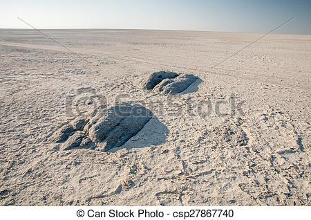 Stock Photo of Granite extrusions inside Makgadikgadi Salt Pan.